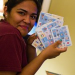 Yadira with a handful of Lotería cards